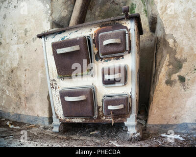 old stove in abandoned rural farm - Stock Photo