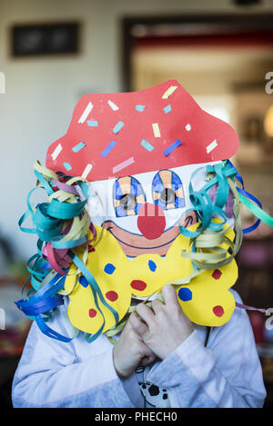 portrait of a child with carnival mask - Stock Photo
