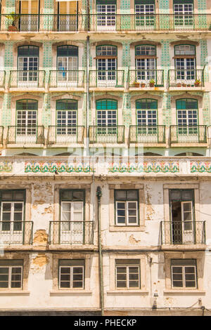 Typical colorful rusty facades wall on houses in Lisbon, Portugal - Stock Photo