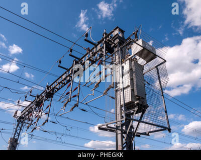 Overhead power lines with transformer for trains UK - Stock Photo