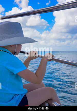 a boy in a hat on a yacht - Stock Photo