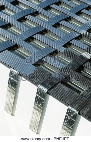 Fragment of a modern building. Abstract crossing lines on facade. - Stock Photo