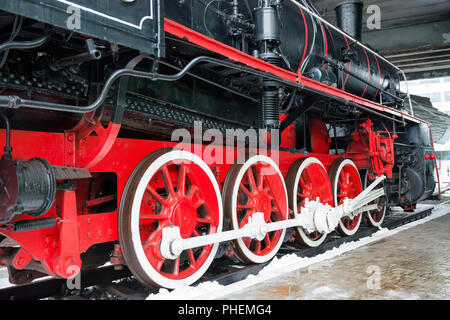 Old black steam locomotive wheels - Stock Photo