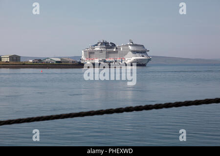The cruise liner MSC Meraviglia with up to 5,000 passengers moored in a deep water berth on the outskirts of Kirkwall, Orkney - Stock Photo
