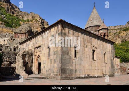 Armenia, Geghard monastery near Yerevan  is a medieval monastery in the Kotayk province of Armenia, being partially carved out of the adjacent mountai - Stock Photo