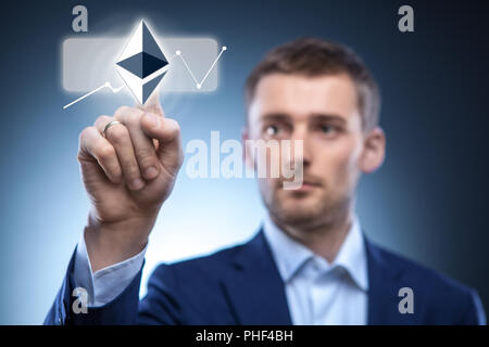 hand man touch the ripple icon on the web screen - Stock Photo