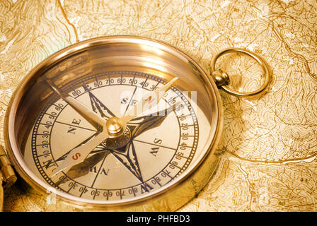 Golden compass on old map - Stock Photo