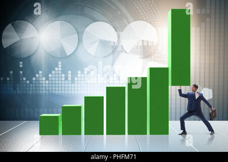 Businessman supporting growtn in economy on chart graph - Stock Photo