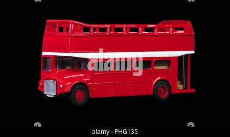 London bus toy isolated on black background - Stock Photo