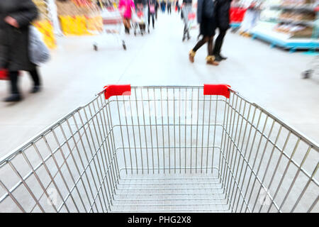 Empty trolley in supermarket - Stock Photo