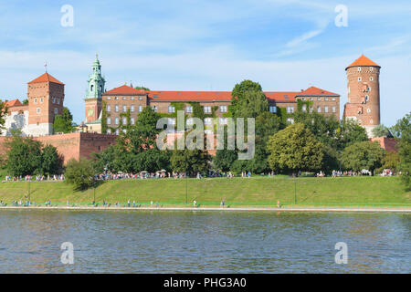 Wawel royal castle view from across the river Vistula (Wisla) at sunset - Stock Photo