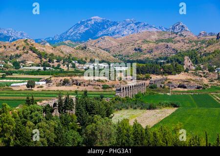 Aqueduct at Aspendos in Antalya, Turkey - Stock Photo