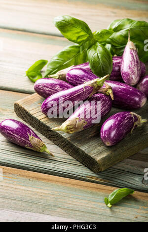 Heap of small eggplant or aubergine Stock Photo