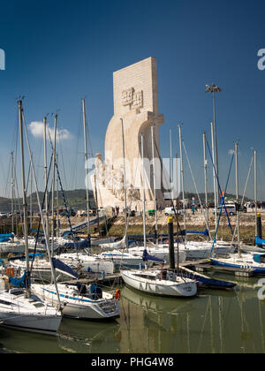 Portugal, Lisbon, Belem, Padrao dos Deccobrimentos, the discoveries monument, behind boats moored in marina - Stock Photo