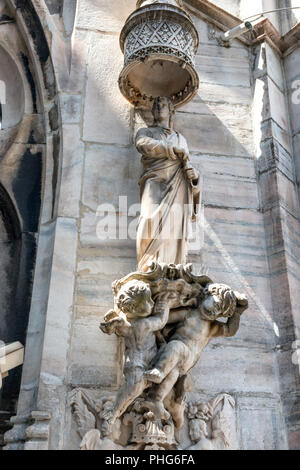Statues on the roof of famous Milan Cathedral Duomo - Stock Photo
