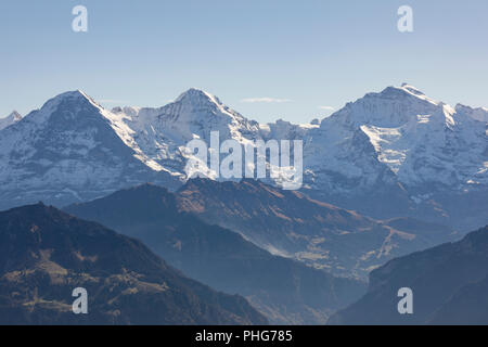 Lauterbrunnen Valley with Eige, Moench and Jungfrau on a beautiful autumn day in the Bernese Oberland in Switzerland - Stock Photo
