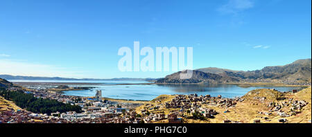 Puno city located on Titicaca lake bank - Stock Photo