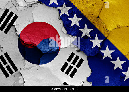 flag of South Korea and Bosnia and Herzegovina painted on cracked wall - Stock Photo