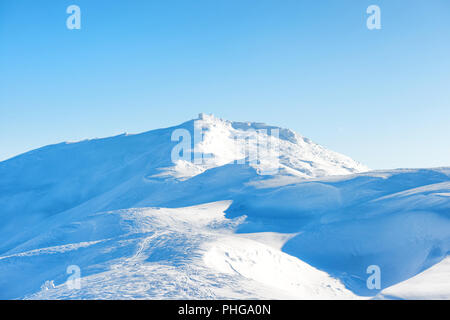 Winter landscape with old castle on top - Stock Photo