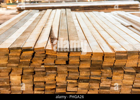 Planks in the timber factory - Stock Photo