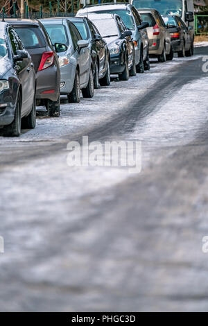 Row of cars parked on the roadside - Stock Photo