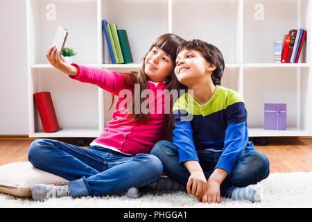 Children taking selfie - Stock Photo