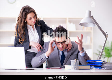 Unhappy boss having a chat with his secretary - Stock Photo