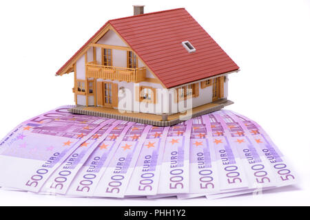 house for sale with Euro banknotes - Stock Photo