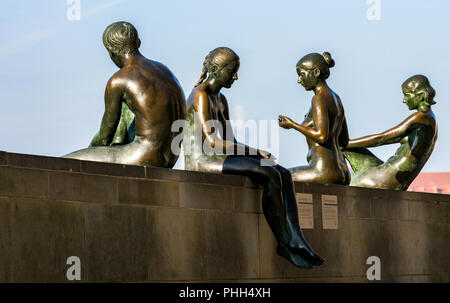 Sculpture of three girls and a boy in Berlin - Stock Photo