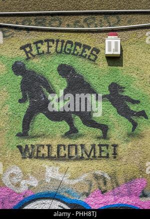 Graffiti, Refugees welcome, Friedrichshain, Berlin, Deutschland - Stock Photo