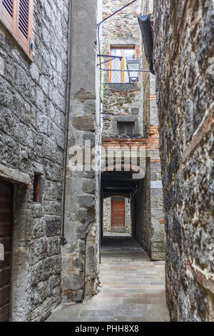 Narrow alley in an old neighborhood - Stock Photo