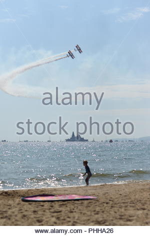 Bournemouth, Dorset, UK, Saturday 1st September 2018, Weather: Warm sunshine on the first day of meteorological autumn on the south coast beach. Large crowds are expected today and tomorrow for the annual Bournemouth Air Festival. Credit: Paul Biggins/Alamy Live News - Stock Photo