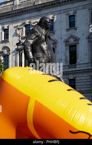 London, U.K. - 1 September 2018: The feet of a balloon mocking London mayor Sadiq Khan as it is inflated in front of the statue of Winston Churchill before being flown in Parliament Square at the Make London Safe protest. Credit: Kevin Frost/Alamy Live News - Stock Photo