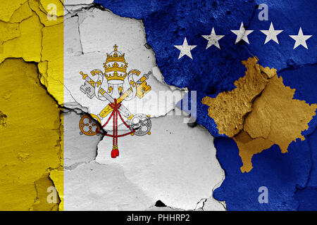 flag of Vatican and Kosovo painted on cracked wall - Stock Photo