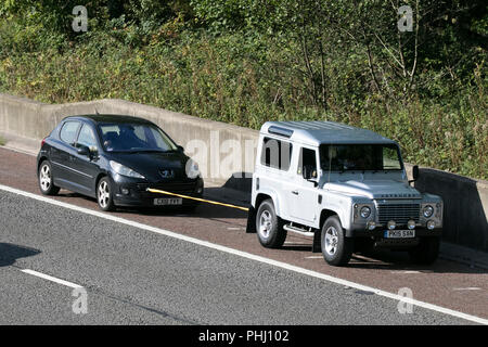 Silver Land Rover Defender 90 XS TD, specialist, collectable future classic cars on the M6 at Lancaster, UK - Stock Photo