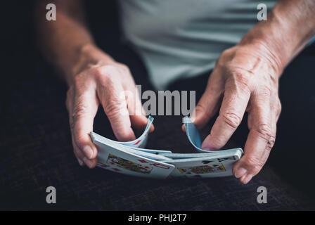 Woman shuffling cards - Stock Photo
