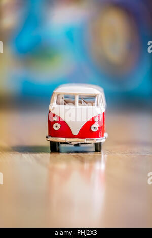 Small toy car on the floor in the living room - Stock Photo