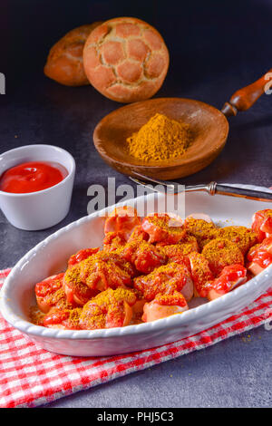 sausage in curry sauce - Stock Photo
