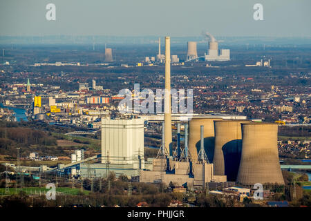View of Hamm with the Gersteinwerk coal-fired power plant at the front and the Westfalen power plant at the rear on the horizon with an extreme teleph - Stock Photo
