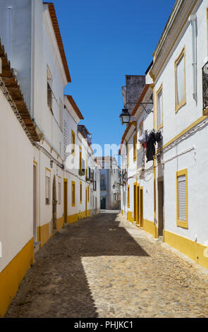 The view of cozy narrow street of Evora. Portugal - Stock Photo