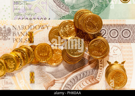 photographed close-up Polish money - zloty, banknotes and coins - Stock Photo