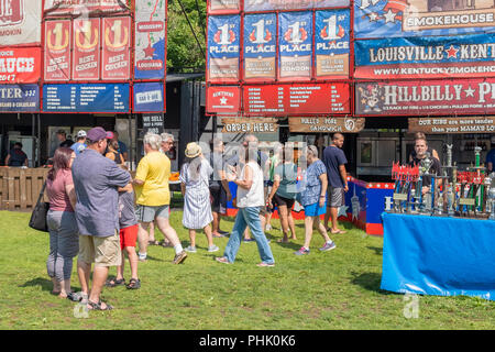 Southern BBQ fans line up to sample award winning barbeque ribs and chicken during Orillia Ontario Ribfest. - Stock Photo