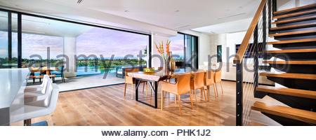 Open plan living area with hardwood floor - Stock Photo