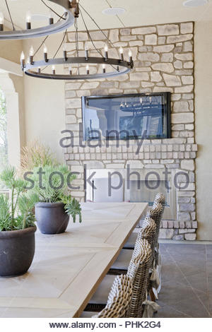 Dining room with stone fireplace - Stock Photo
