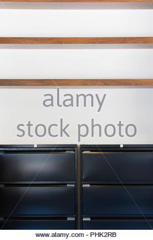 Filing cabinets under shelves - Stock Photo