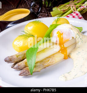 asparagus with egg and fresh wild garlic - Stock Photo