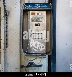 Disused pay phone in Downtown Los Angeles, California. - Stock Photo