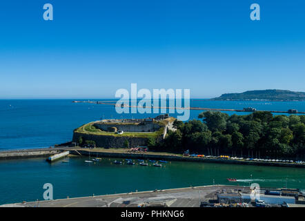 High shot of Nothe Fort  in Weymouth with the Isle of Portland and Portland harbour in the distance, Dorset, England, UK - Stock Photo