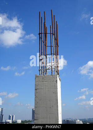 Reinforcement concrete column as part of building structure at the construction site. Reinforcement bar on top of column ready for next stage of const - Stock Photo