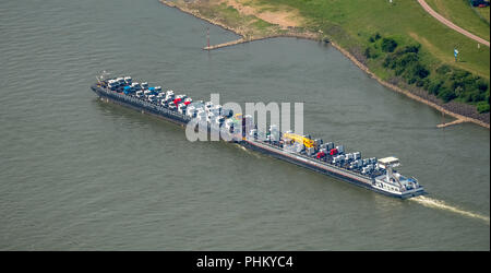 Aerial view, cargo ship on the Rhine goes uphill, push boat with additional lighters, tractors and trucks are the freight, inland navigation Duisburg, - Stock Photo